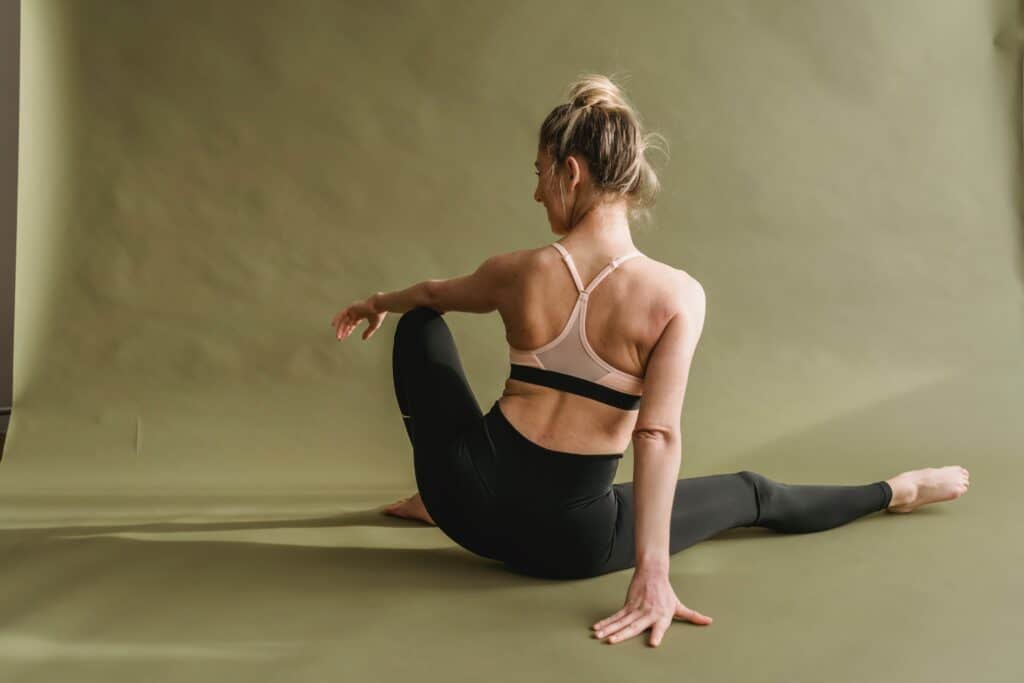 A woman wearing leggings while stretching
