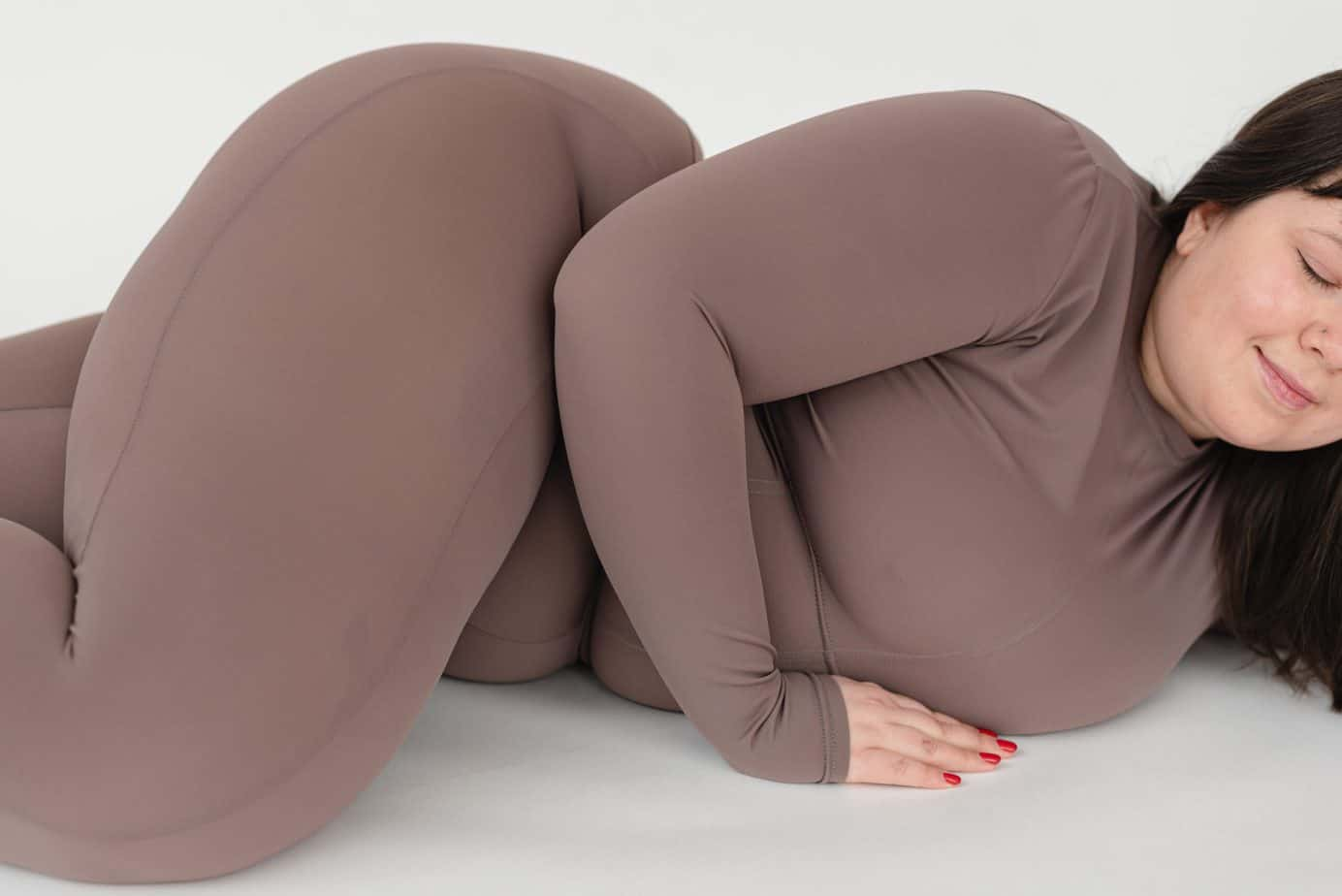 a woman lying on the floor wearing a plus size leggings