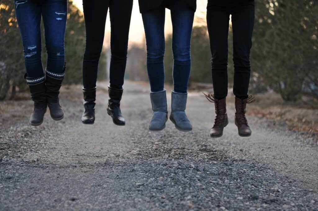 four people wearing leggings and jeans