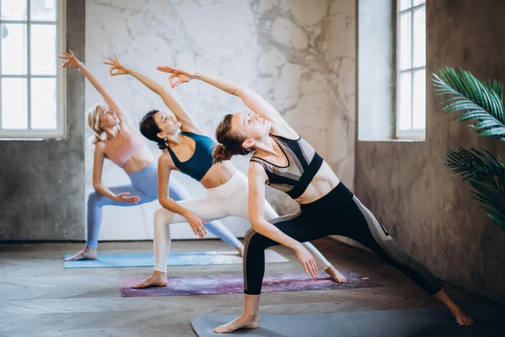 a group of fit women wearing different types of leggings