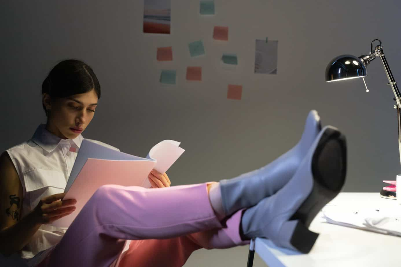 a person reading wearing a pink velvet leggings