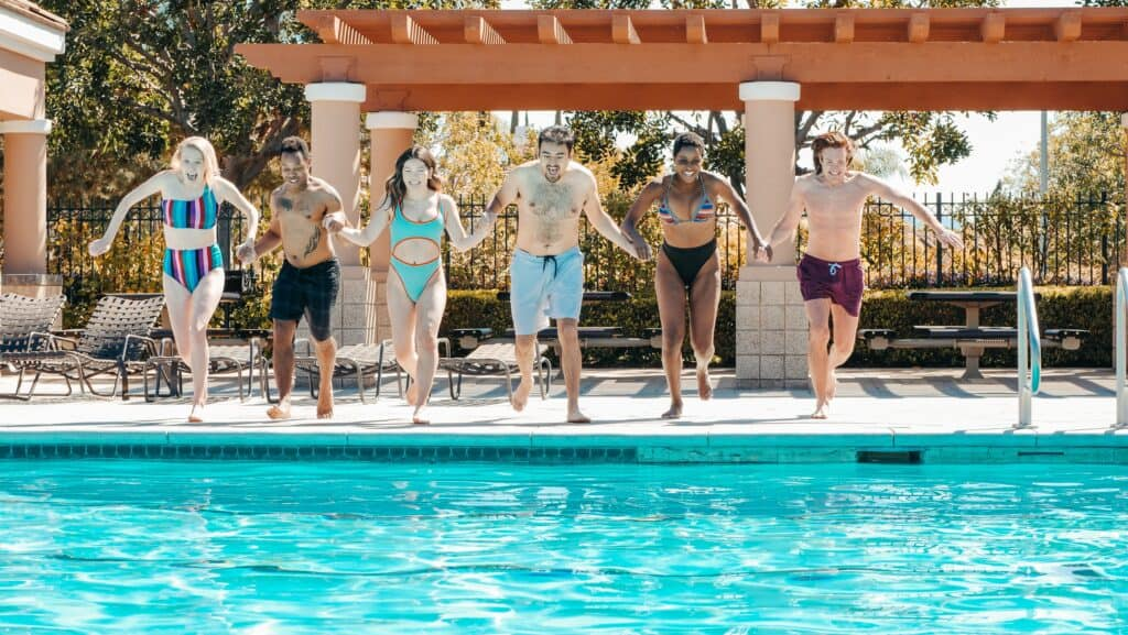 a group of people enjoying the swimming pool