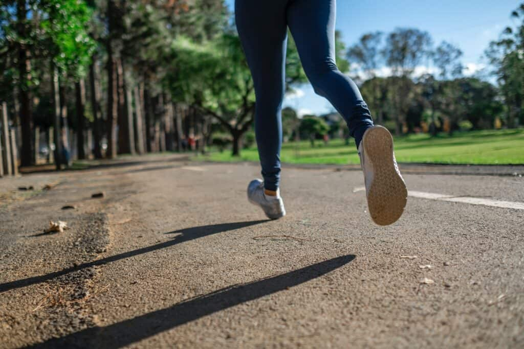 a person running wearing leggings