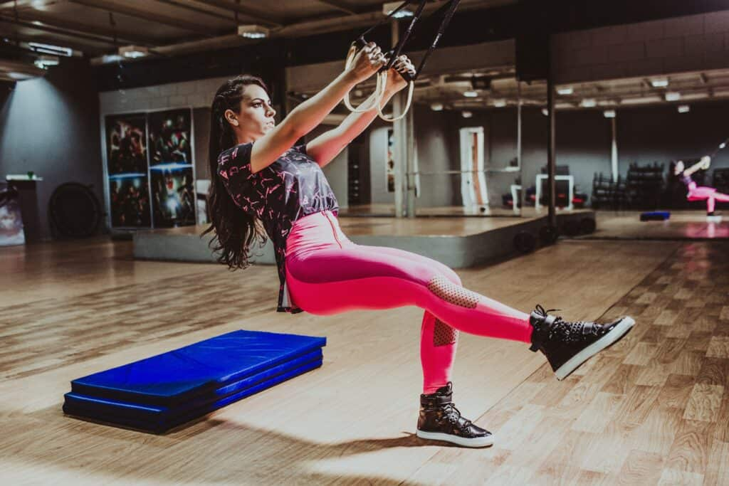 a woman wearing leggings while doing workout